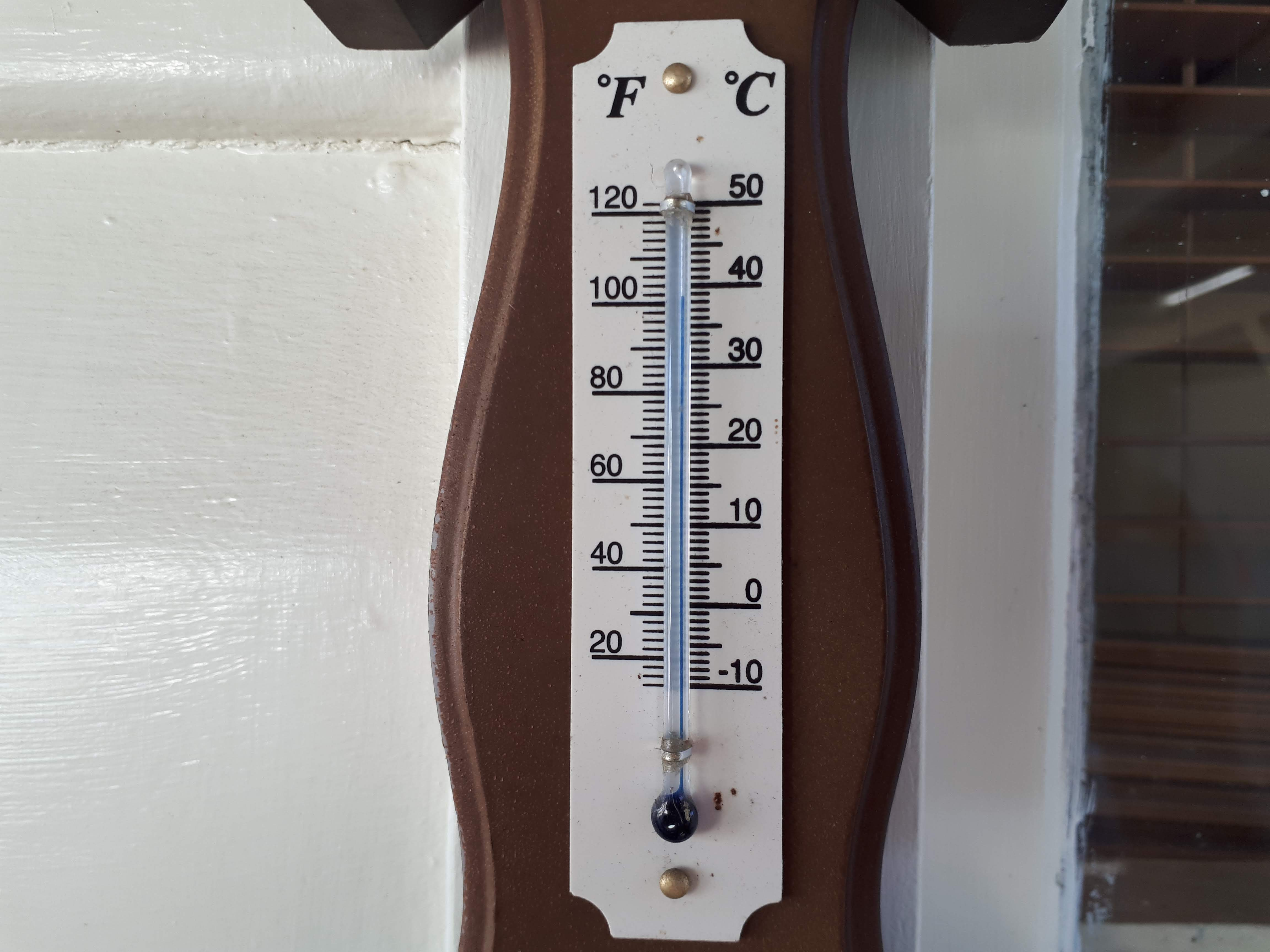 Thermometer reading 39 degrees C.